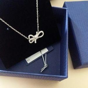 Swarovski crystal bow pendant